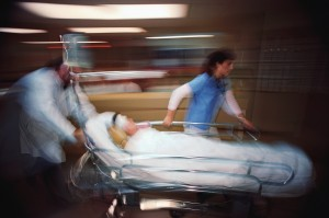 Physician and Nurse Pushing Gurney