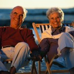Happy Older Couple in Beach Chairs