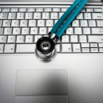 Laptop and Stethoscope --- Image by © Royalty-Free/Corbis